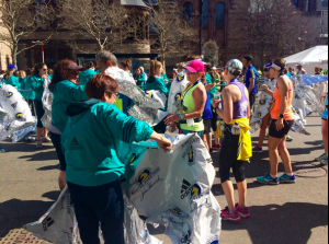 Volunteers handing out blankets to runners at the Boston Marathon. Priscilla Liguori/ WEBN-TV