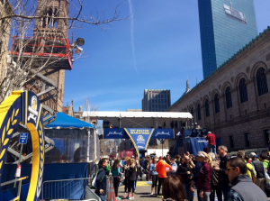 Runners and spectators taking pictures at the Boston Marathon finish line the day before the race. Priscilla Liguori/ WEBN-TV